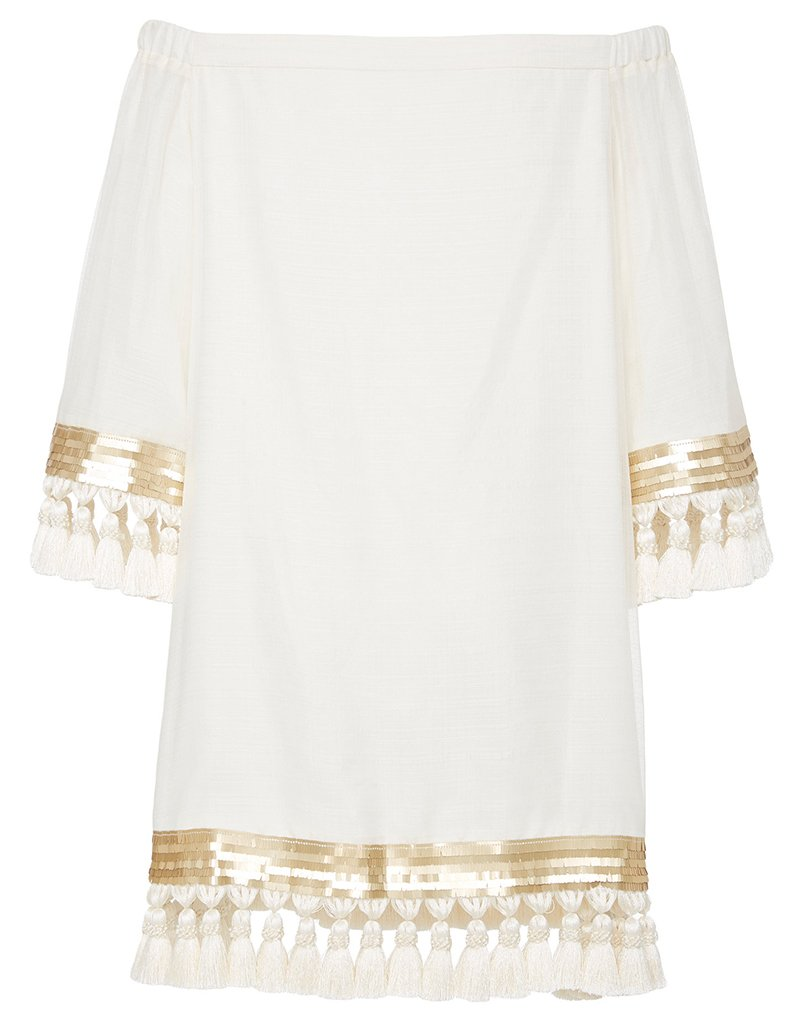 Back image of white tassel dress with gold detailing and cold shoulder neckline.