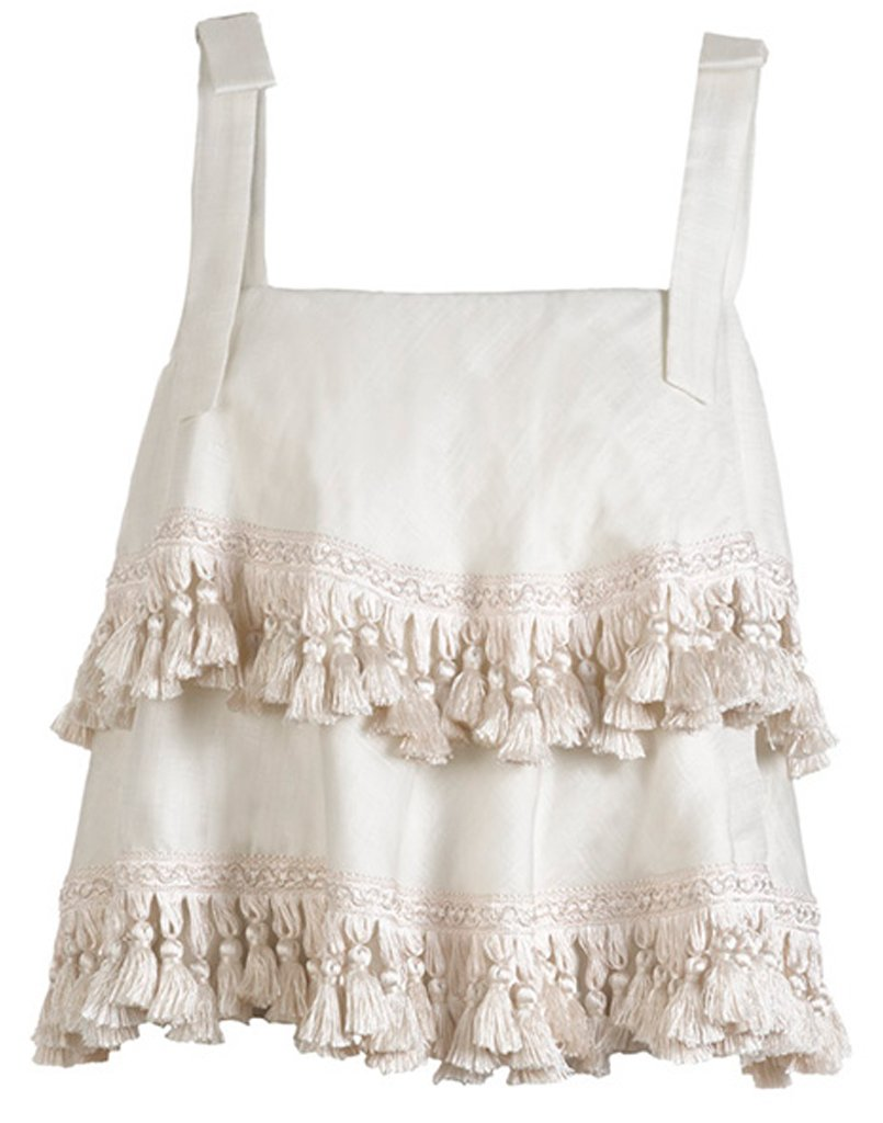 Fun white Palma Tassel Top from Mstiza New York with tiers of tassels is the perfect addition to any summer closet.
