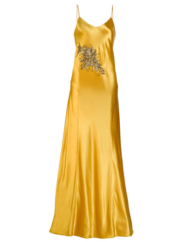 Mestiza New York. Carmen Diamond Gown with embellishment in Dandelion gold. Gold silk slip dress. Made in New York City. Hammered Liquid Satin Back Crepe. Slip on entrance. Adjustable straps. Tri-Acetate and Polyester blend. Dry clean.