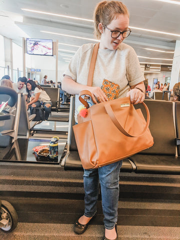 airport traveling with aquila vegan leather tote bag