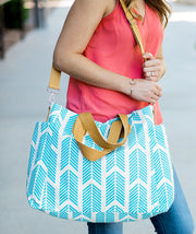 Model carrying the Aqua Blue Arrows Weekender Tote Bag