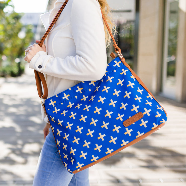 Model posing with the Crosses Hobo Crossbody Bag in blue