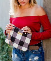 Model posing with the Aquila Clutch Bag in Buffalo Check