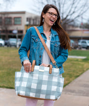 white elm gray buffalo check gingham tote bag held crossbody with model