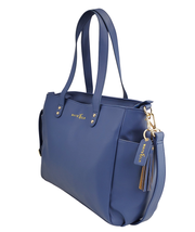 Navy blue vegan leather White Elm tote bag side view with tassel