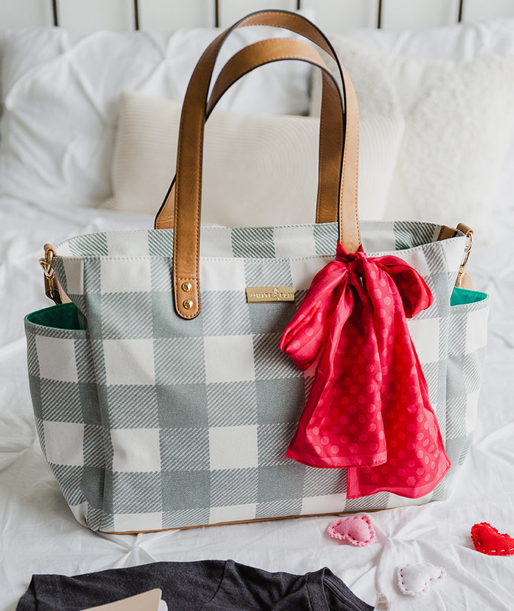 gray buffalo plaid tote bag by White Elm on bed with bow