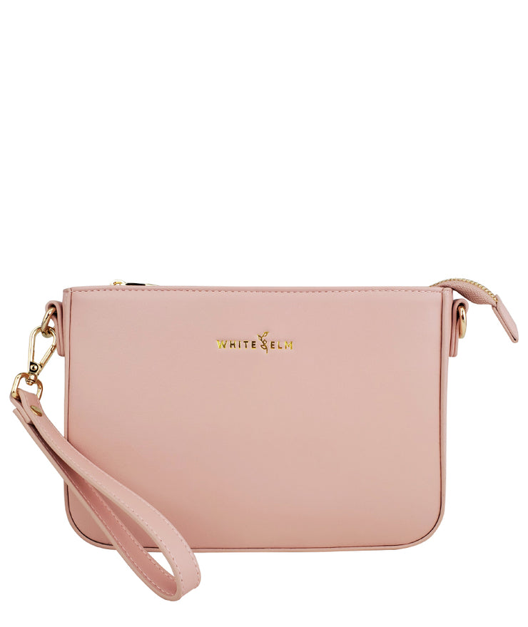 pink crossbody clutch vegan leather bag by white elm front