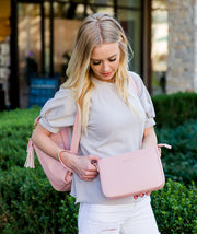 Ara pink crossbody clutch vegan leather bag by white elm with gemini backpack
