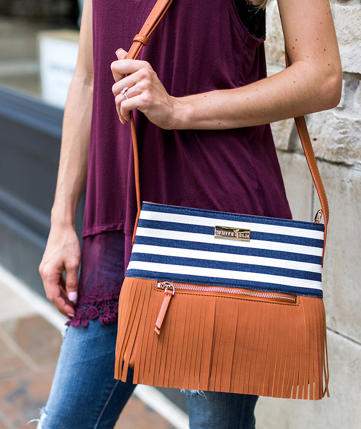Model posing with the Blue Stripes Boho City Fringe Crossbody Bag over her shoulder