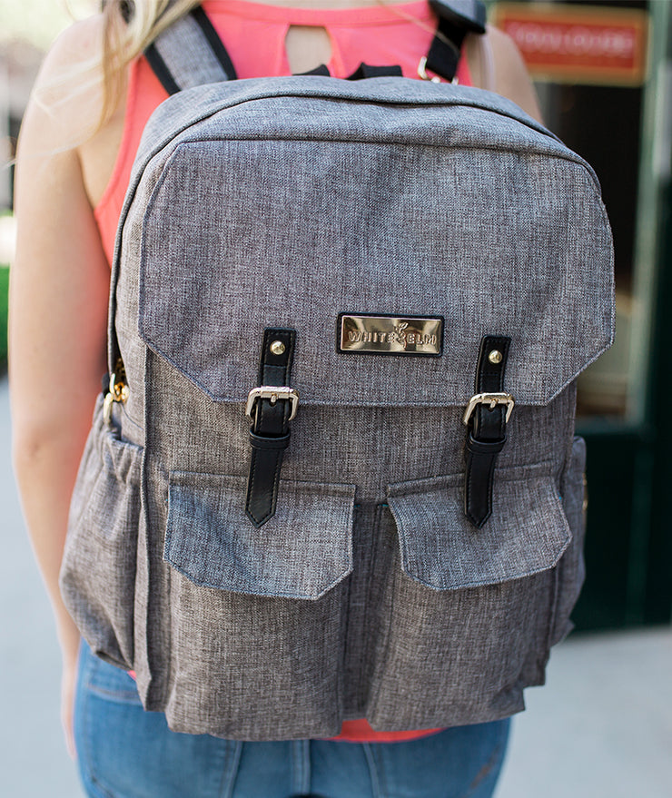 Woman wearing the Jet City Diaper Bag Backpack as a backpack