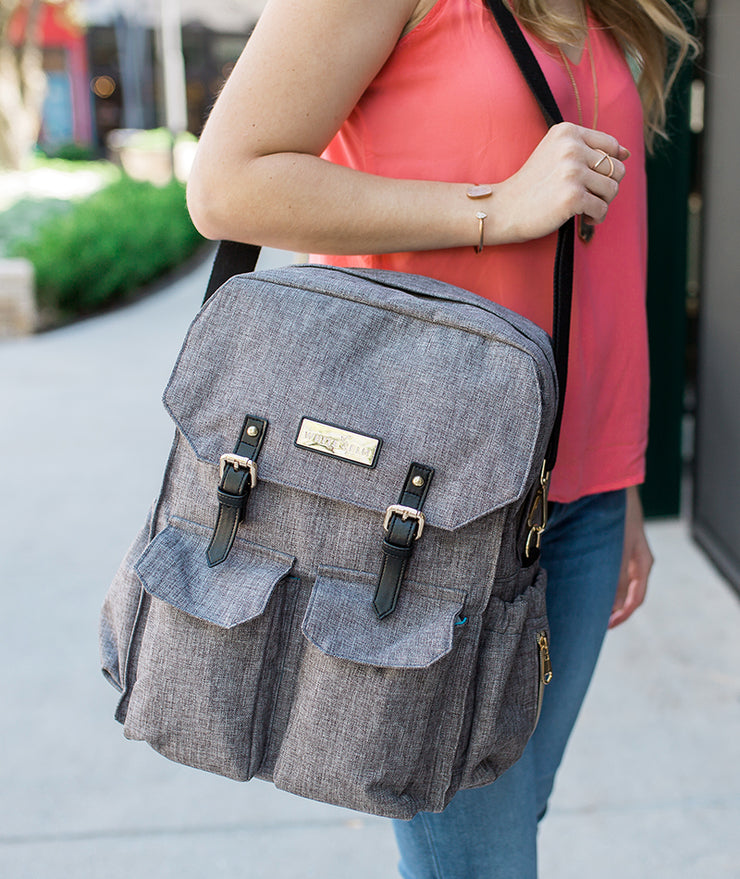 Woman carrying the Jet City Diaper Bag Backpack over her shoulder