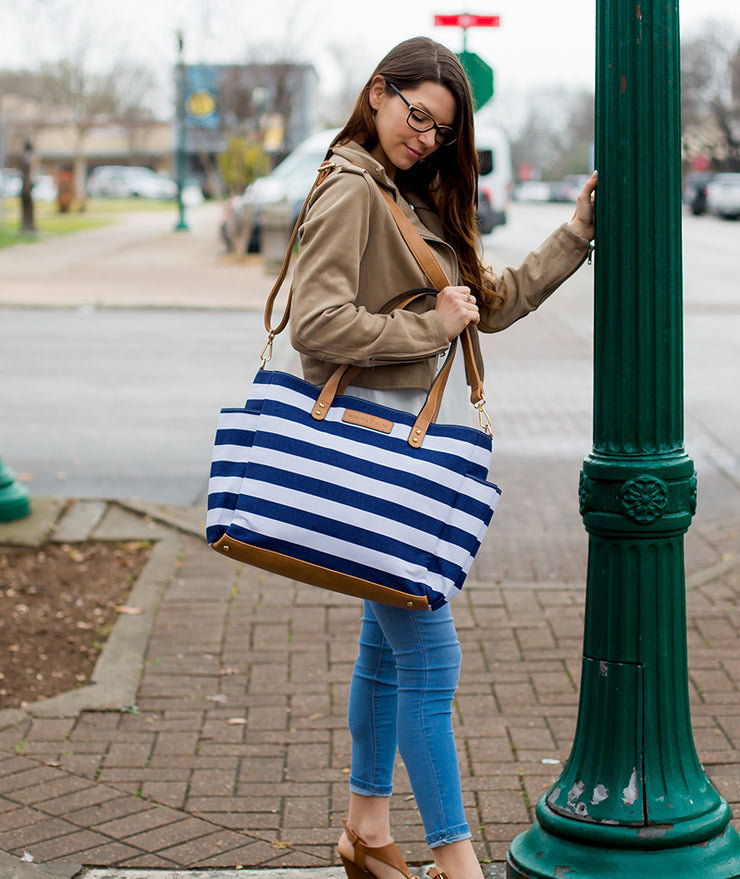 Model posing with Aquila Tote Bag In Navy Blue Stripe