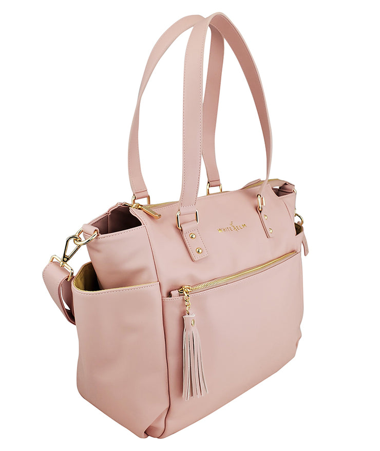 Gemini convertible backpack in pink vegan leather by white elm side view