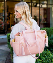 Gemini convertible backpack in pink vegan leather by white elm worn as a backpack