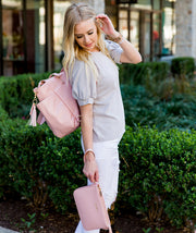 Gemini convertible backpack in pink vegan leather by white elm with ara pink vegan leather clutch
