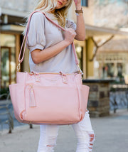 Gemini convertible backpack in pink vegan leather by white elm worn crossbody