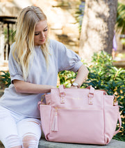 Gemini convertible backpack in pink vegan leather by white elmGemini convertible backpack in pink vegan leather by white elm getting into