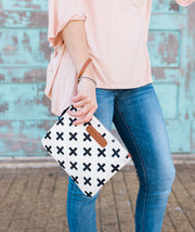 Model wearing the Crosses Clutch Bag in white around her wrist