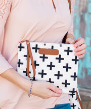 Close-up of model holding the Crosses Clutch Bag in white