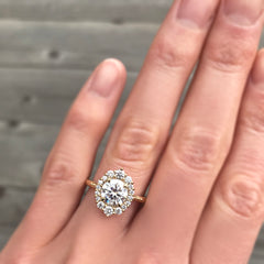 Conflict-free Diamond Center with a diamond halo in 14k yellow gold