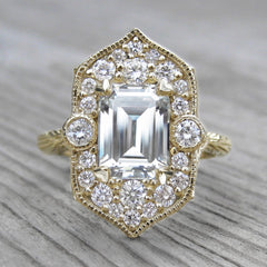Estella halo ring with an Emerald Cut Forever One Moissanite