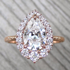 Engagement Ring with a Pear Moissanite Center with Diamond Halo in Rose Gold