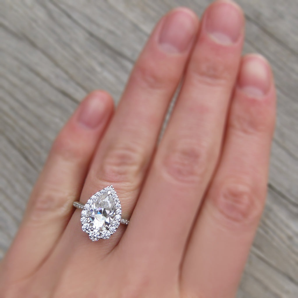 Large Moissanite Pear Cut Halo ring in platinum, modeled