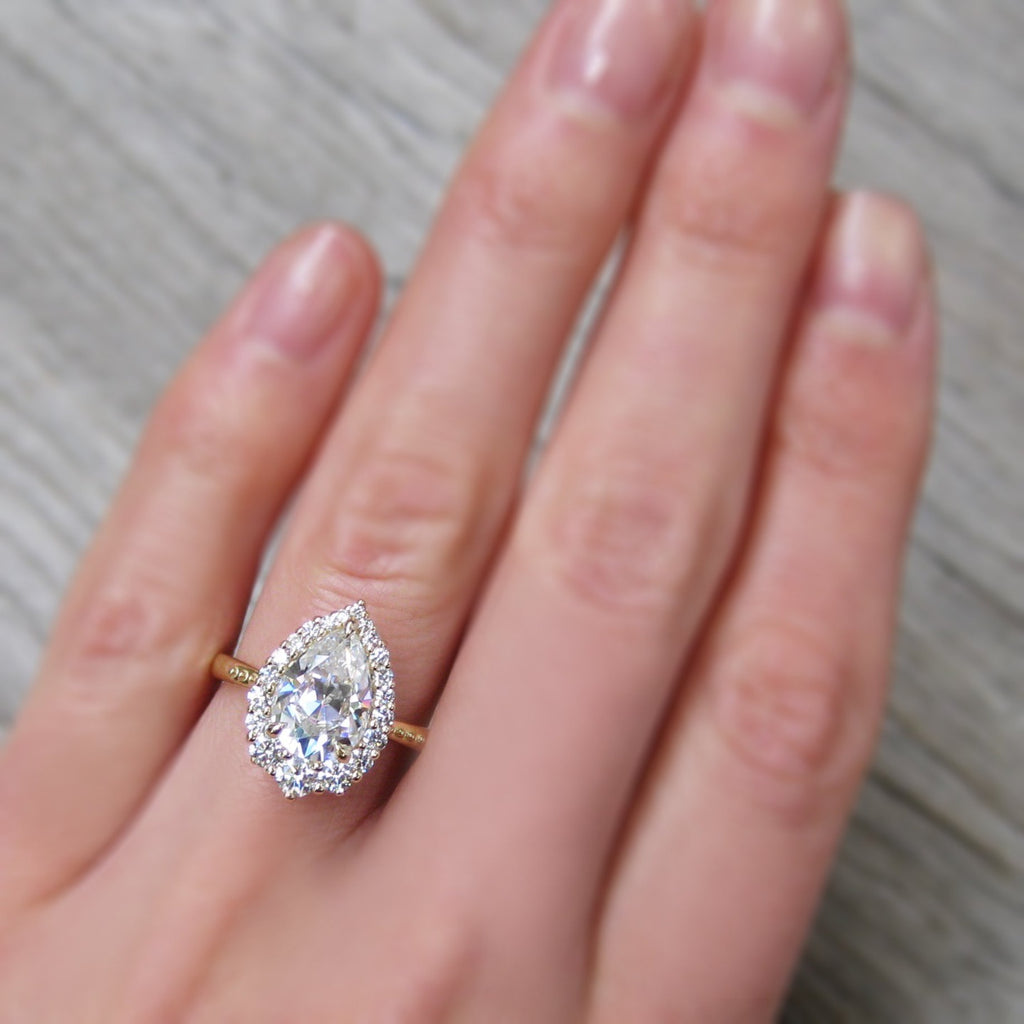 Large Celeste Pear Moissanite halo ring modeled