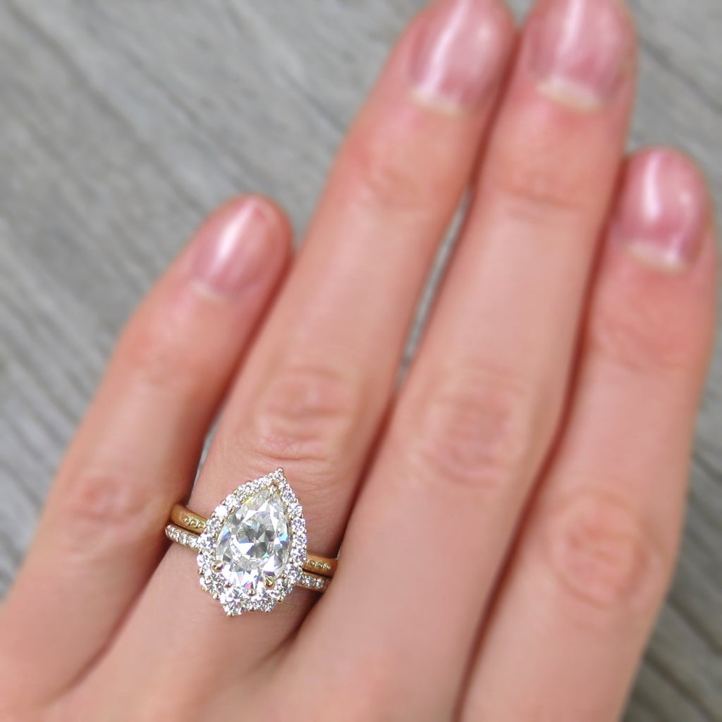 Large Celeste Pear Moissanite halo ring modeled with diamond band