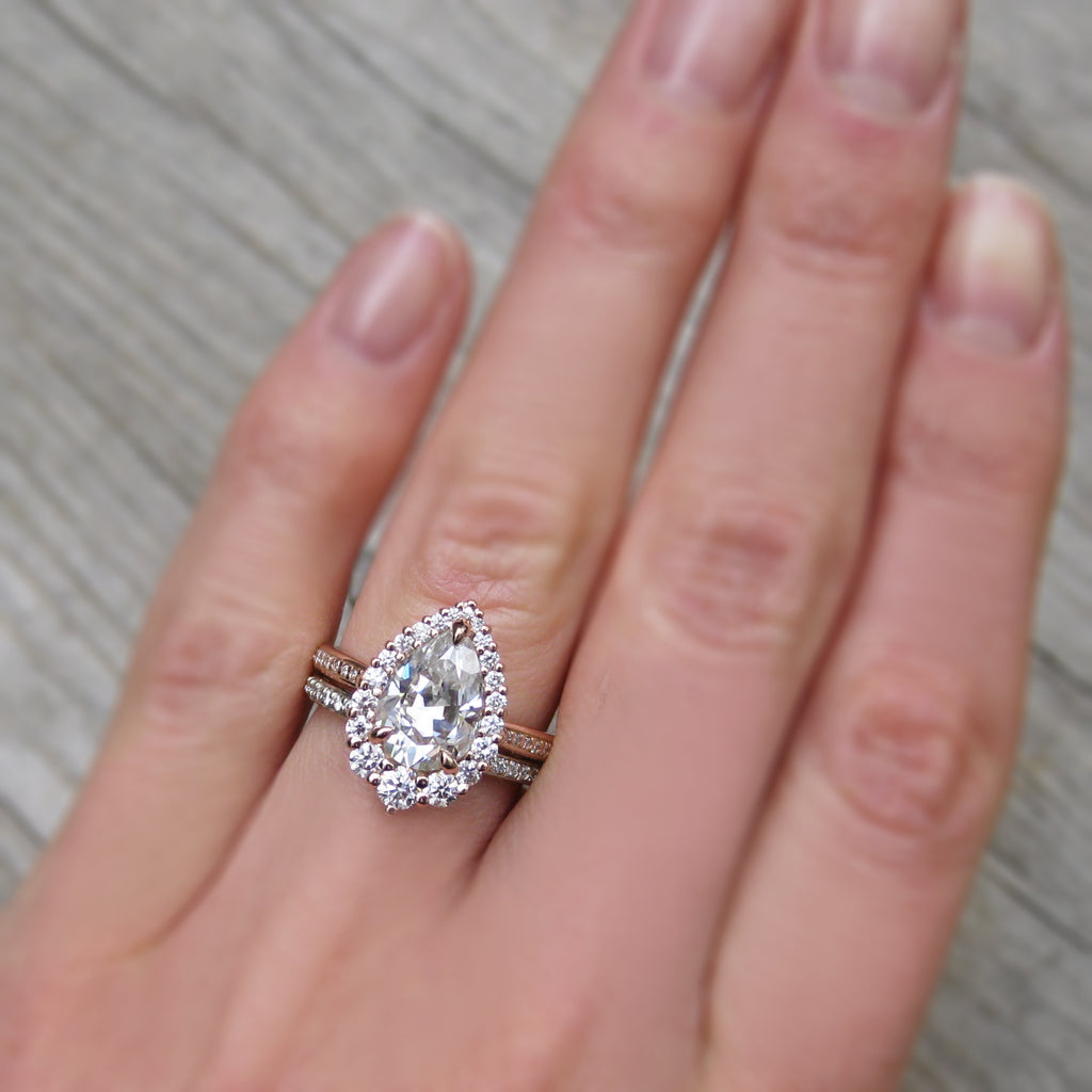 Pear Cut Engagement ring with pavé diamond band and halo