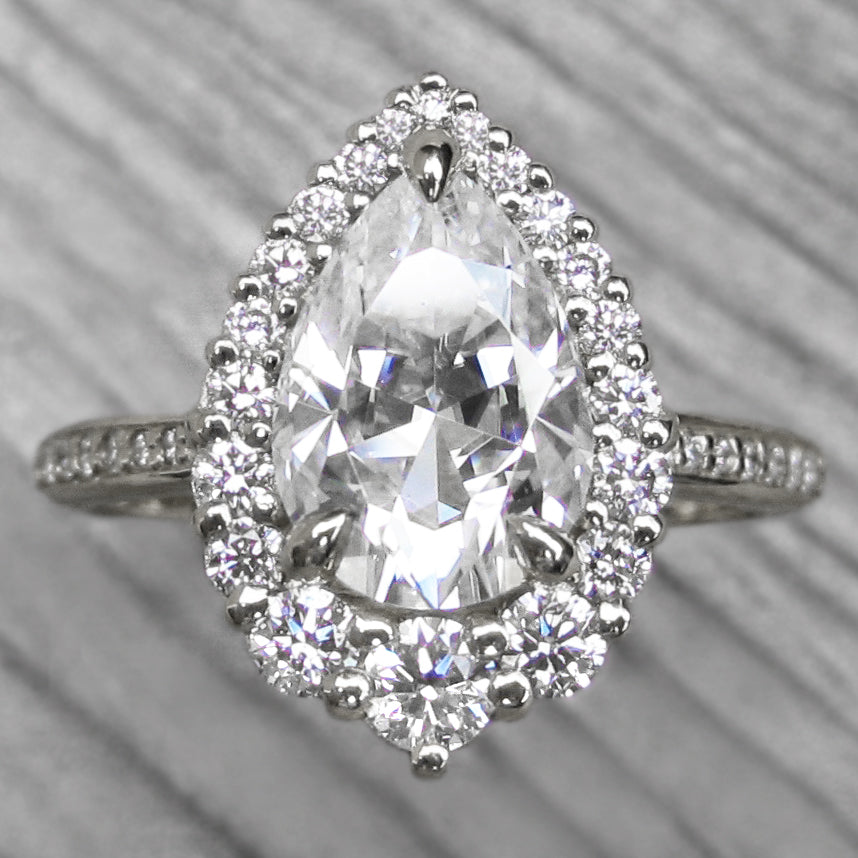 Pear cut halo engagement ring, platinum with diamond shank