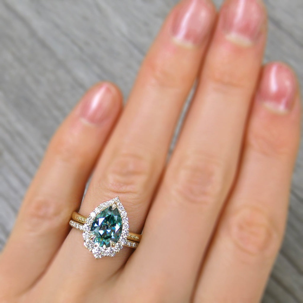 <center><strong>・CELESTE・</strong><br></center>Aqua-Teal Iconic™ Pear Moissanite Center, Diamond Halo (2.58ctw+)