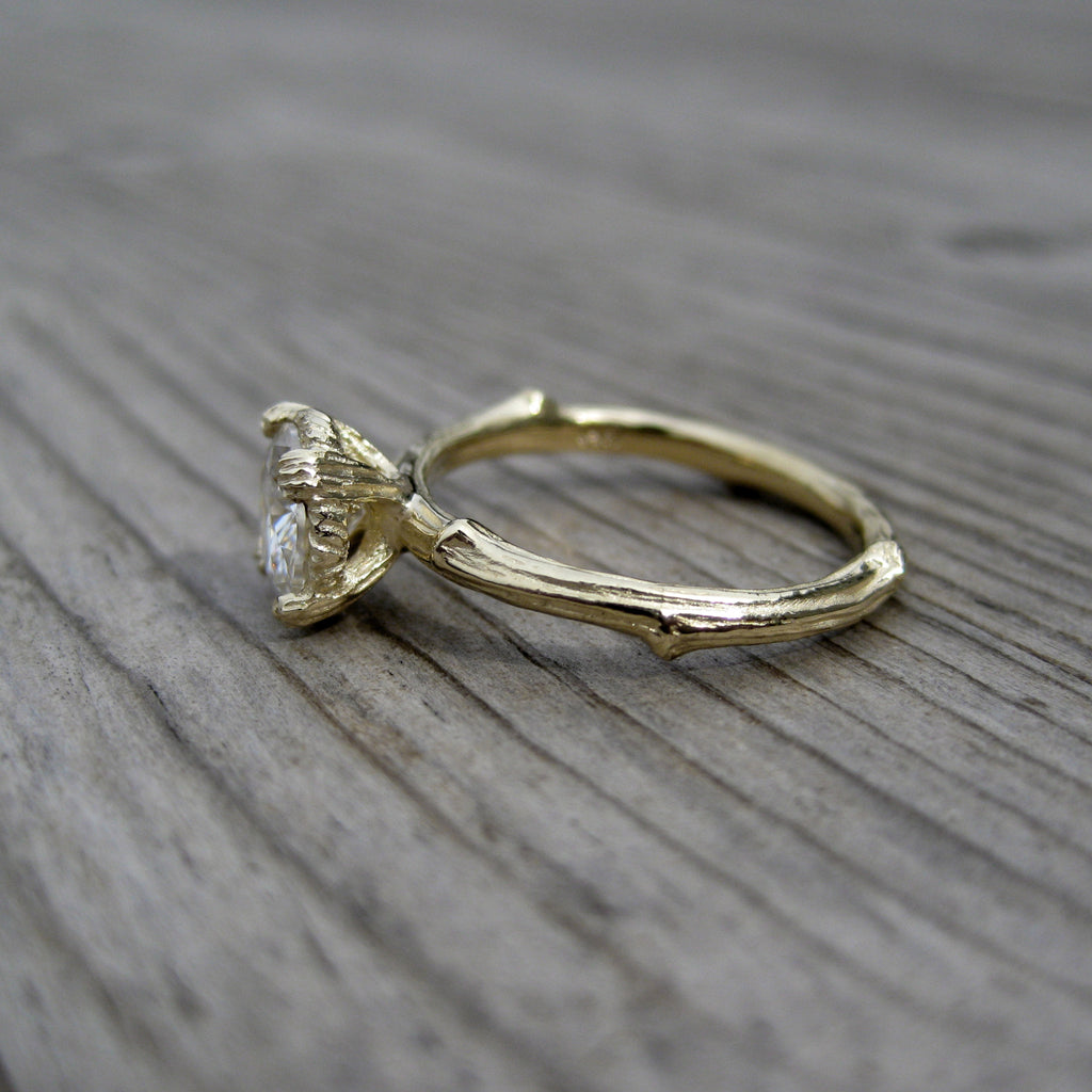 1ct Forever One Hearts & Arrows moissanite engagement ring in 14k yellow gold