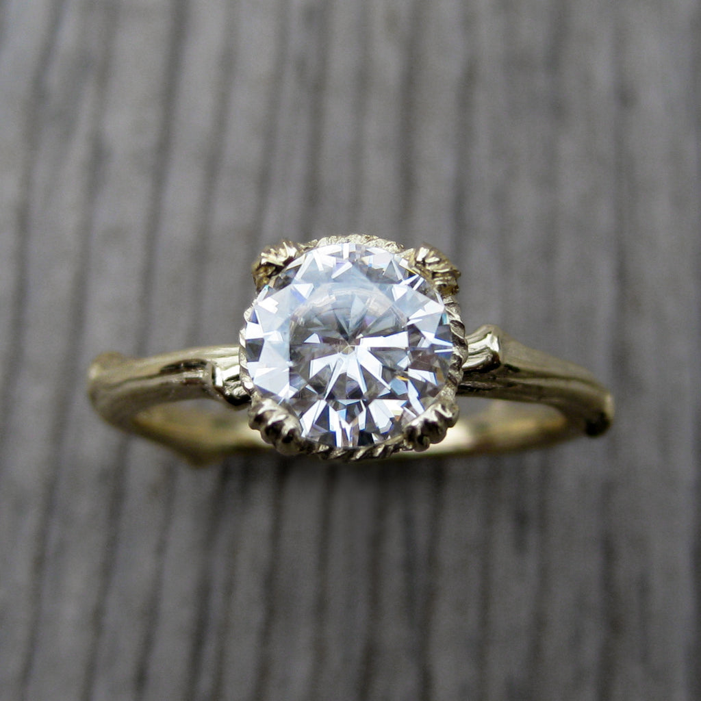 1ct yellow gold twig solitaire engagement ring with a Forever One Hearts & Arrows moissanite