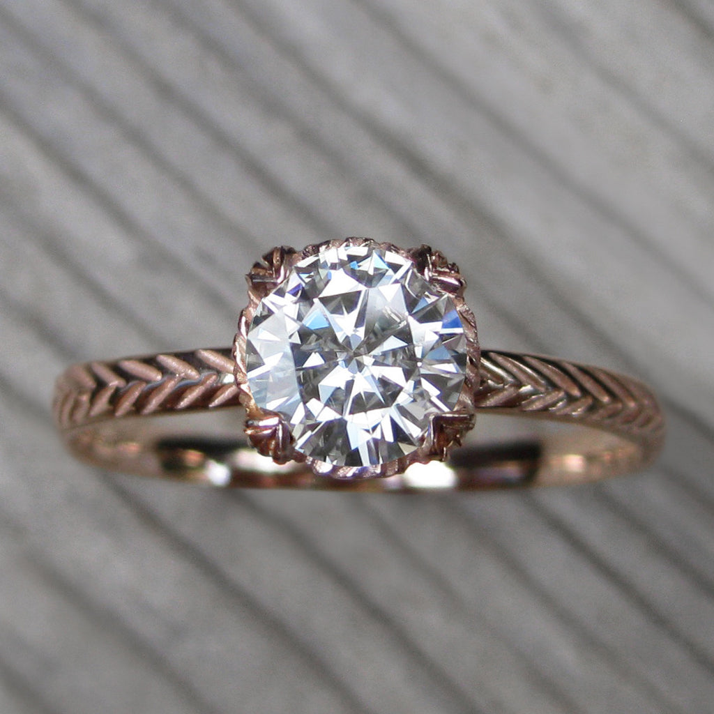 1ct rose gold solitaire engagement ring with a Forever One Hearts & Arrows moissanite