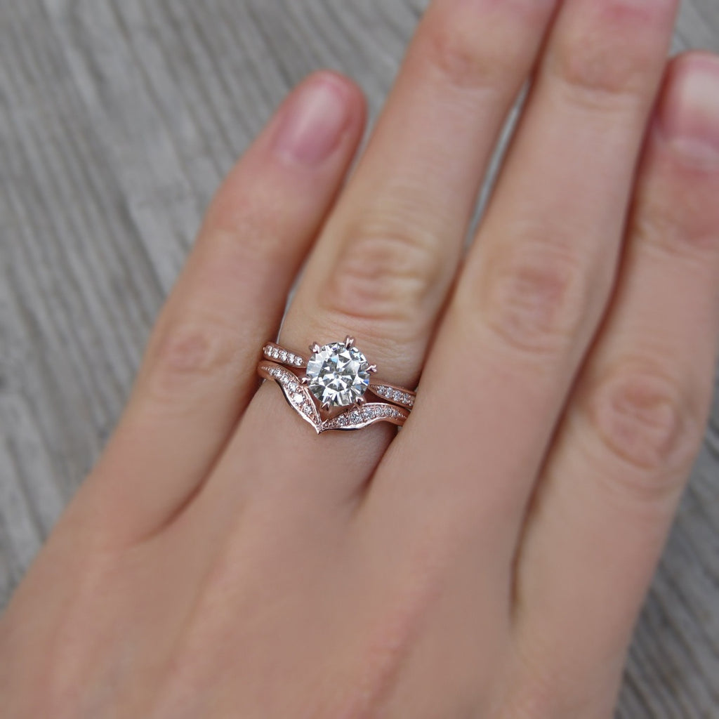 1 carat solitaire engagement ring with a conflict-free diamond wedding band
