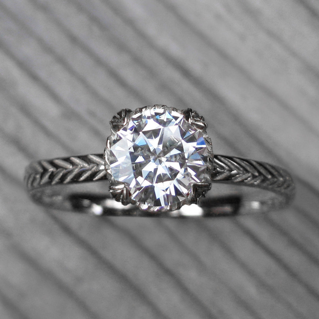 1ct white gold solitaire engagement ring with a Forever One Hearts & Arrows moissanite