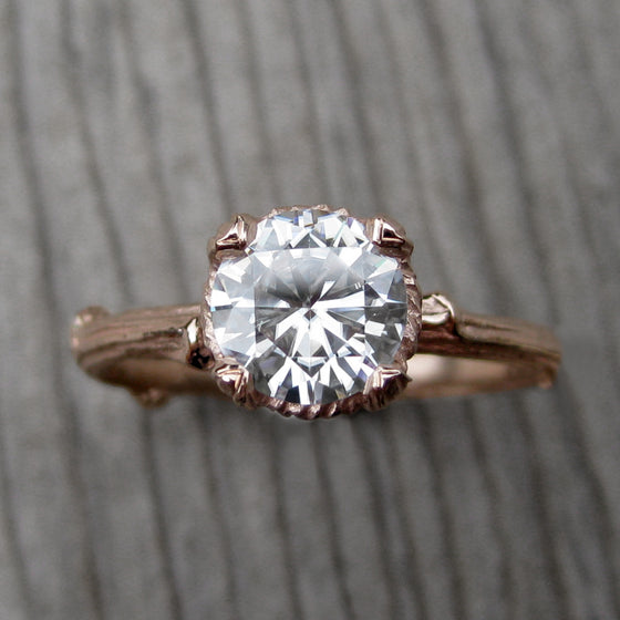 1ct rose gold twig solitaire engagement ring with a Forever One Hearts & Arrows moissanite
