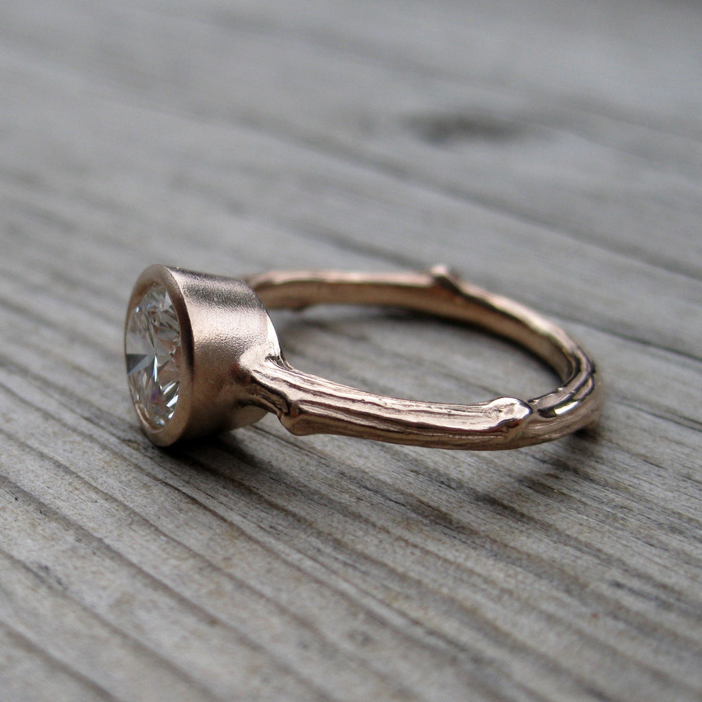 1ct twig bezel solitaire engagement ring with a 14k rose gold stackable band, side view