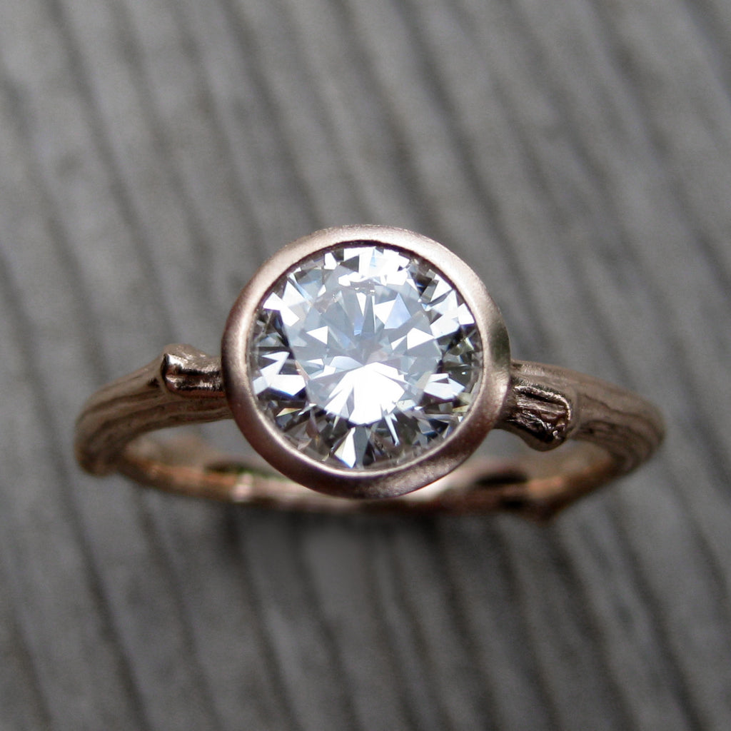 Top view of solitaire twig engagement ring with a lab grown diamond in 14k rose gold