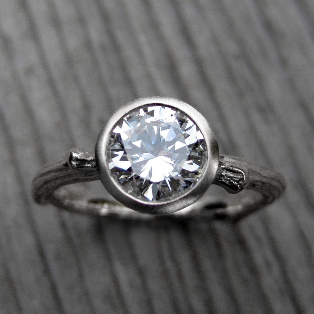 Top view of solitaire twig engagement ring with a lab grown diamond in 14k white gold