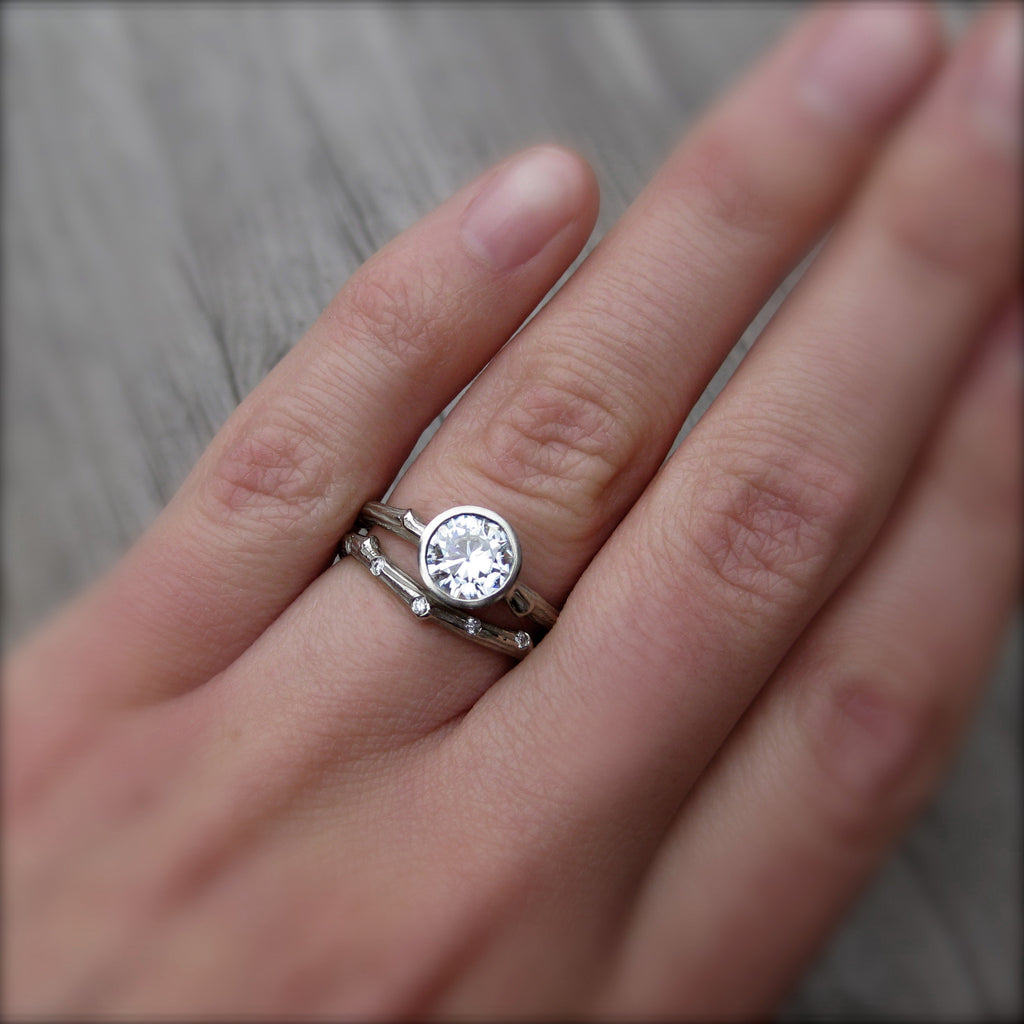 solitaire engagement ring with conflict free diamond in 14k gold modeled on finger