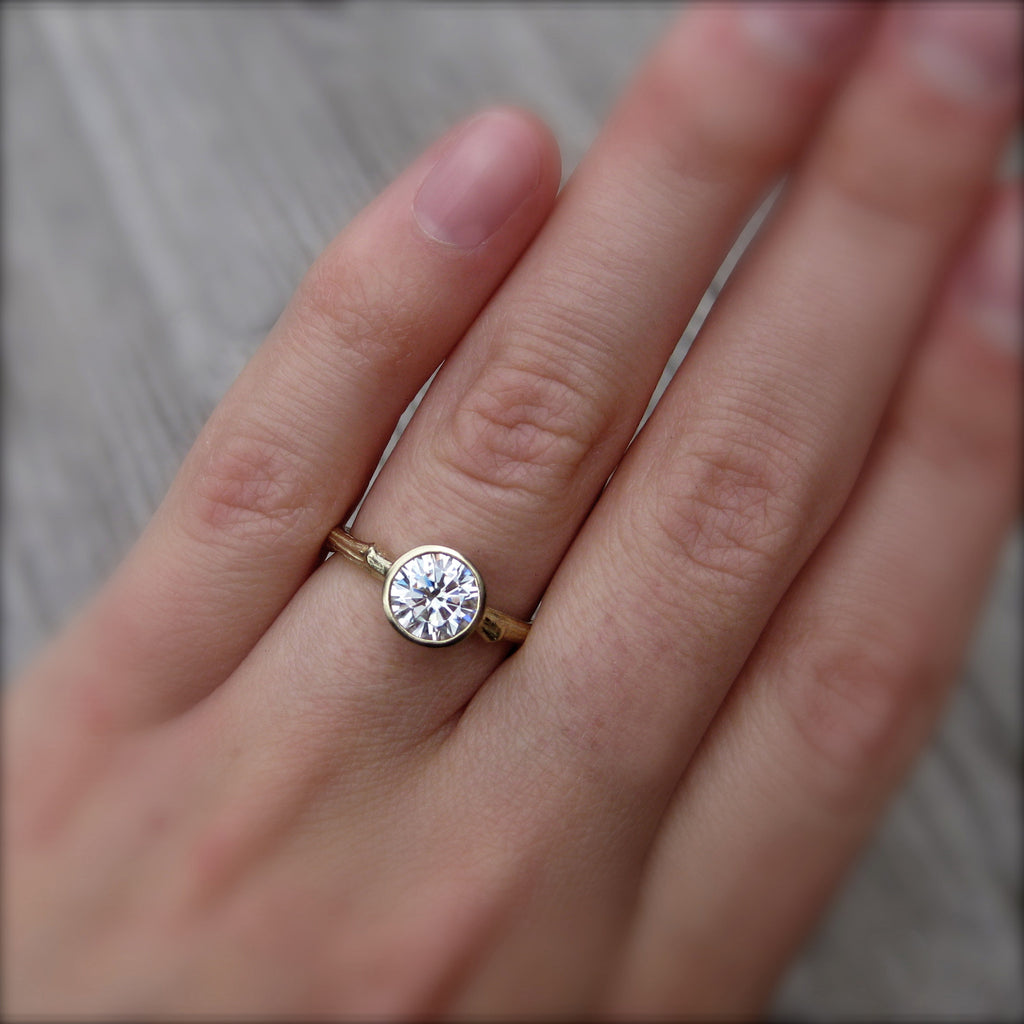 Eco-friendly engagement ring with conflict free diamond in 14k gold modeled on finger