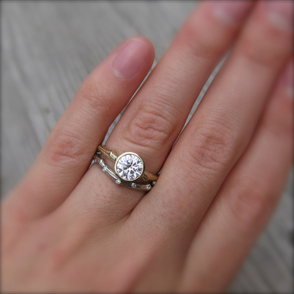 Eco-friendly engagement ring with environmentally friendly diamond in 14k gold modeled on finger