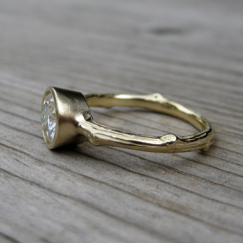 1ct twig bezel solitaire engagement ring with a 14k gold stackable band, side view
