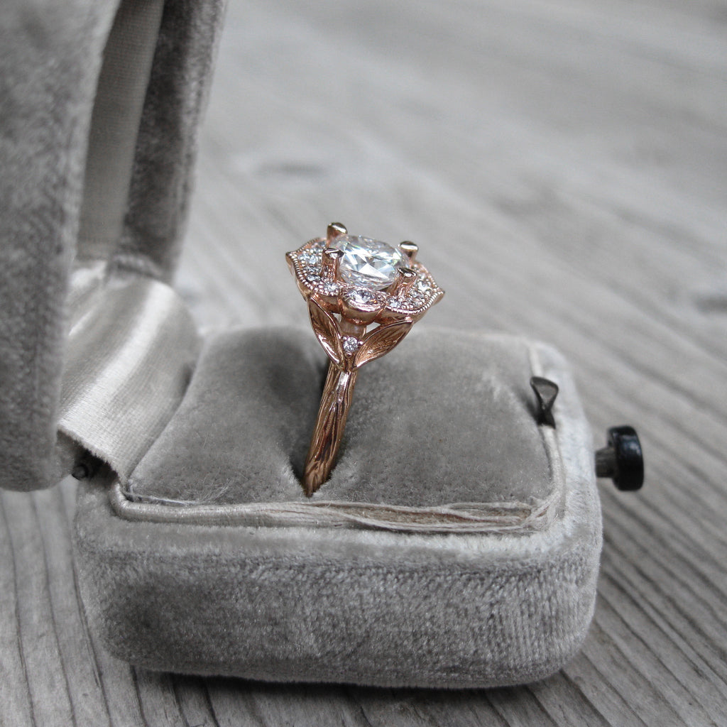 1.5ct Cushion cut halo ring with ethical diamonds in rose gold in engagement ring box