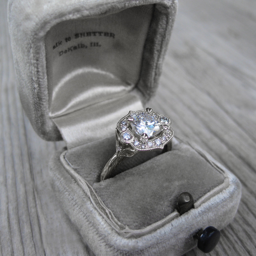 Charles & Colvard Cushion cut moissanite halo engagement ring with ethical diamonds