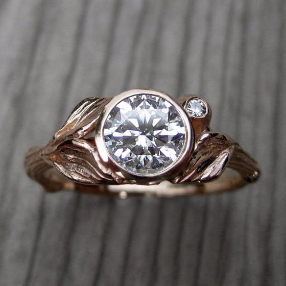 1ct rose gold twig and leaf bezel engagement ring with a Forever One moissanite