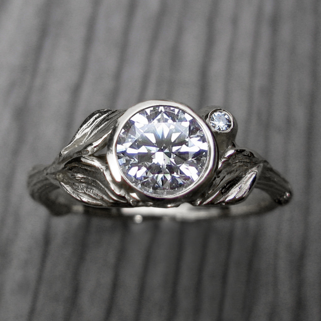 1ct white gold twig and leaf bezel engagement ring with a Forever One moissanite