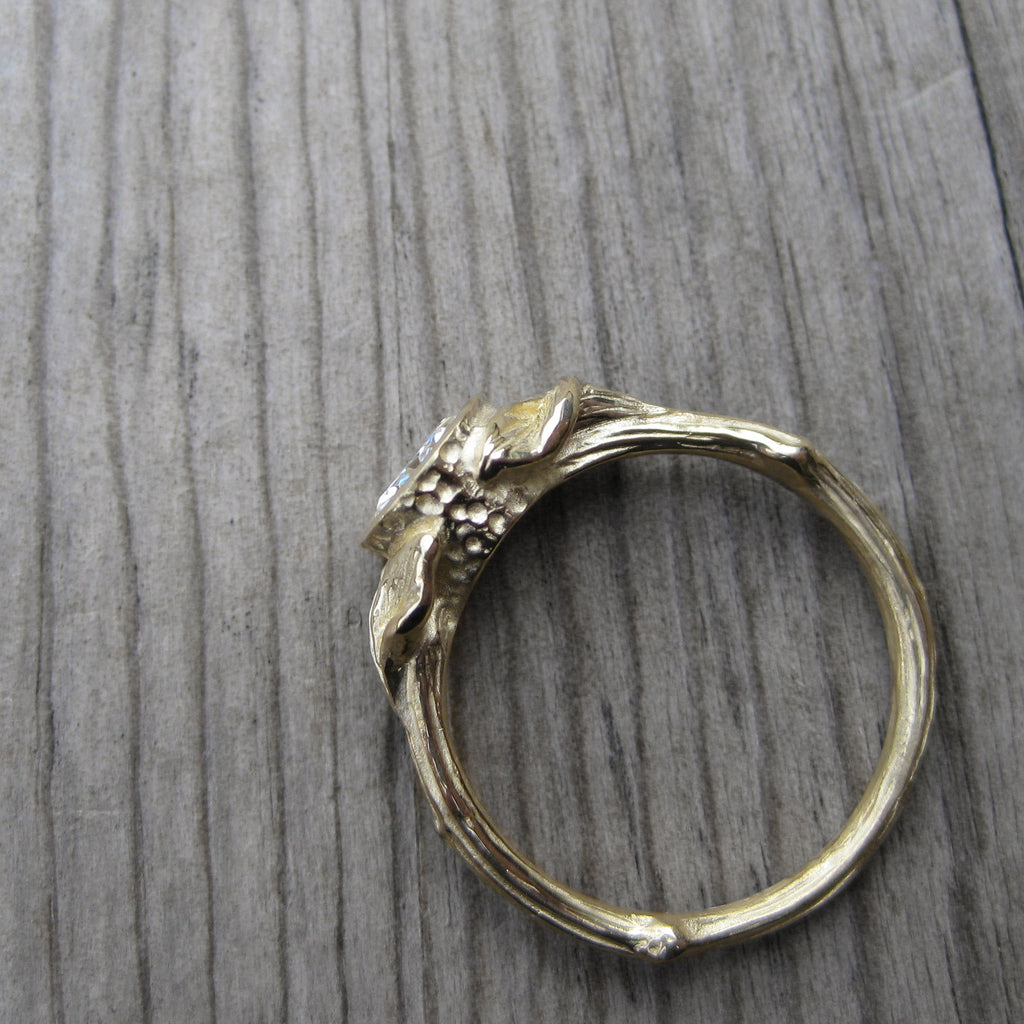 1ct yellow gold twig and leaf bezel engagement ring with a Forever One  moissanite